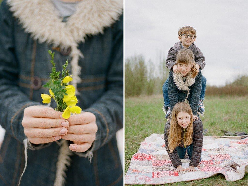 Bryant family photographer : girl holding yellow flowers