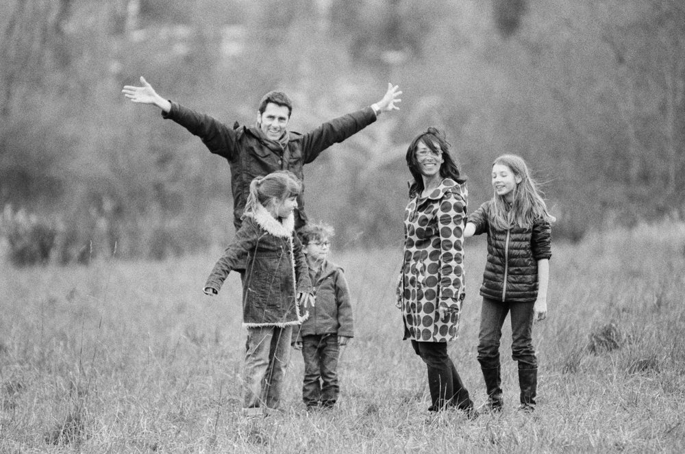 Bryant family photographer : black and white photo of family having fun in a field