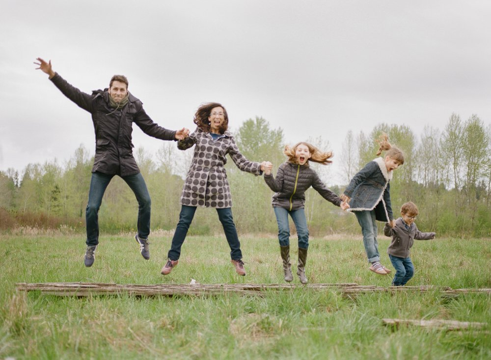 Bryant family photographer : family of five jumping off a log