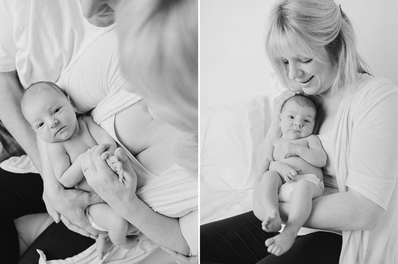 Seattle newborn photographer : newborn awake and looking at camera while mom holds him