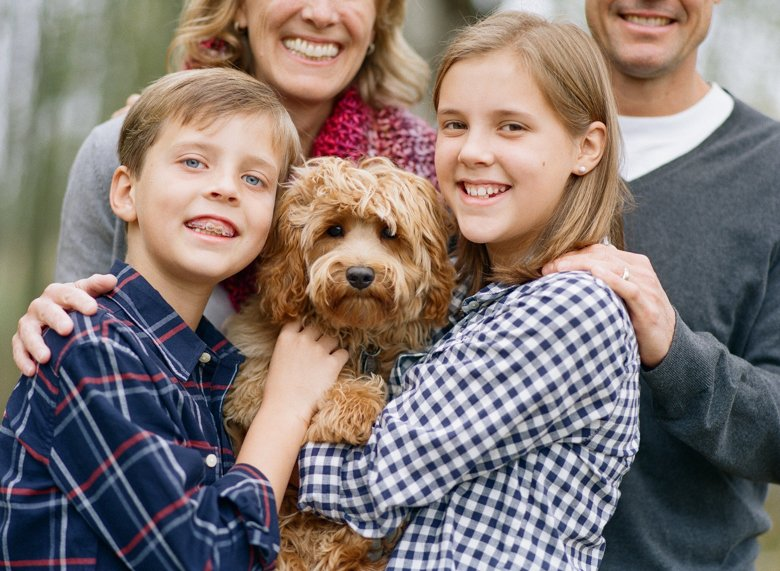 family photography with dogs Seattle : close up of kids with labradoodle