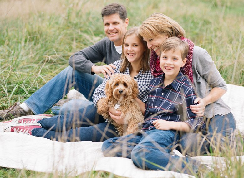 family photography with dogs Seattle : family smiling with dog