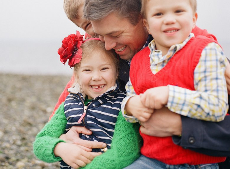 family photographer north seattle : dad cuddling all three kids
