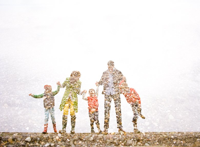 family photographer north seattle : double exposure of family standing holding hands on log