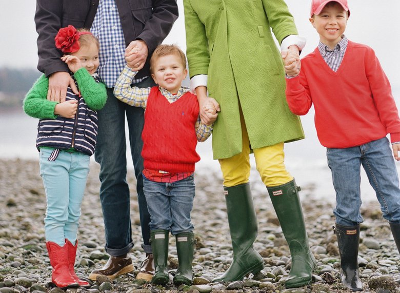 family photographer north seattle : family standing holding hands kids smiling at camera
