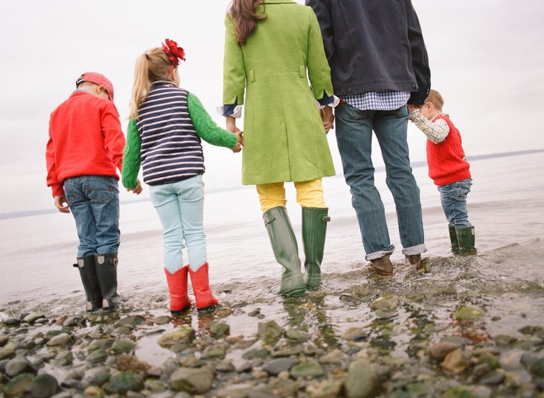 family photographer north seattle : family holding hands looking out at ocean
