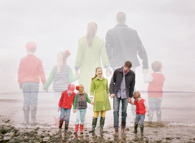 family photographer north seattle : double exposure of family of five standing holding hands on beach