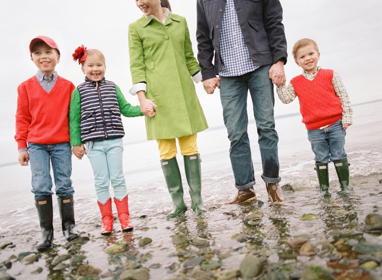 family photographer north seattle : family of five holding hands standing in shallow water smiling