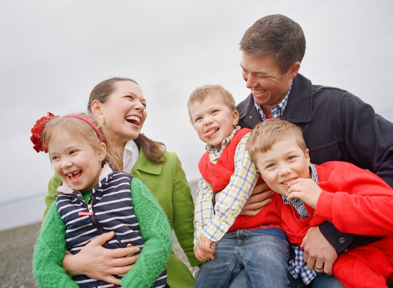 family photographer north seattle : family sitting and laughing all cuddled together