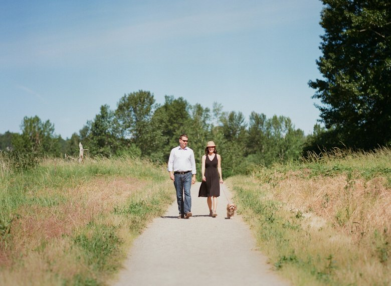 view ridge family photography : partners walking dog on dirt path