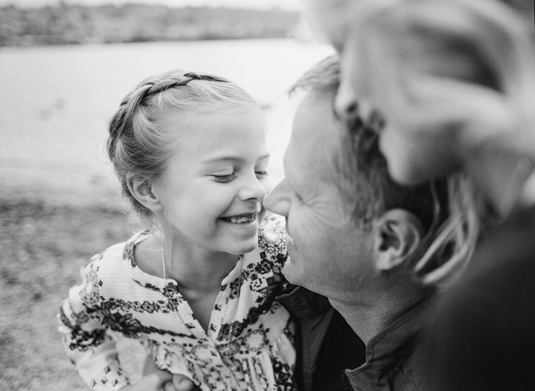best family photographer sister   girl touching nose with dad