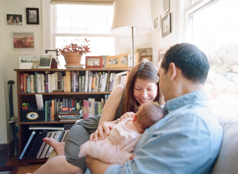 north seattle newborn photography in home session : family with newborn on couch