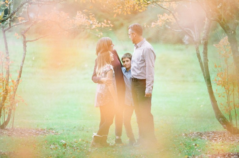 outdoor family session tween : family standing in grove of trees