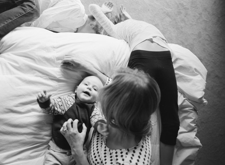 in home candid family photo session | kids and mom on bed