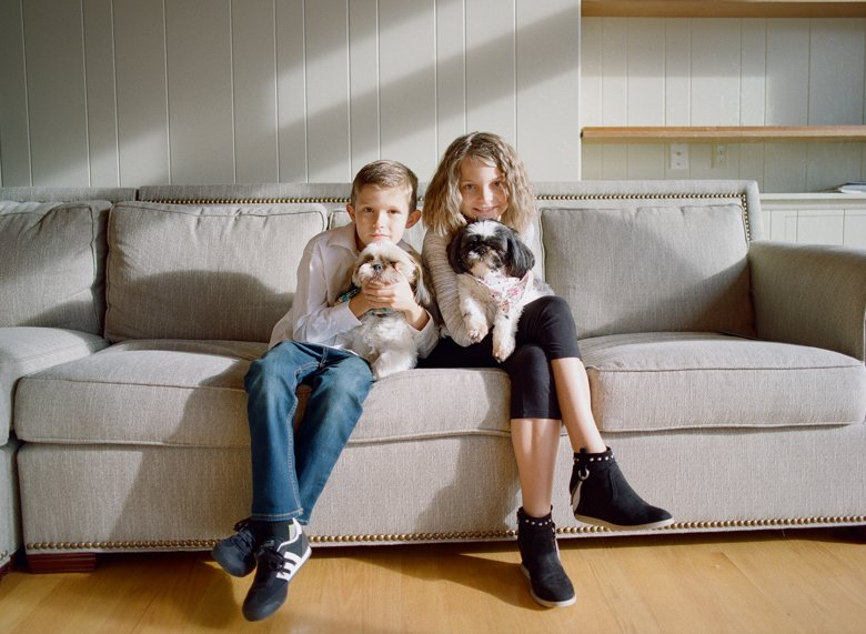 in home candid family photo session | kids with dogs on couch