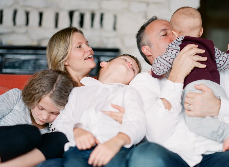 in home candid family photo session | family cuddling