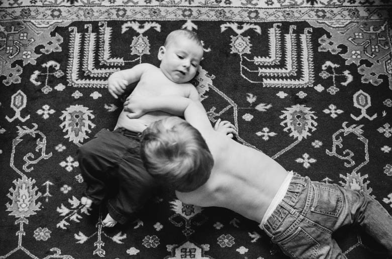 in-home family photos Seattle WA : brothers hanging out on rug