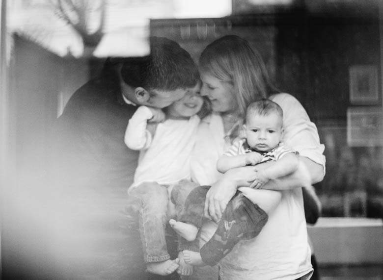in-home family photos Seattle WA : couple cuddling kids