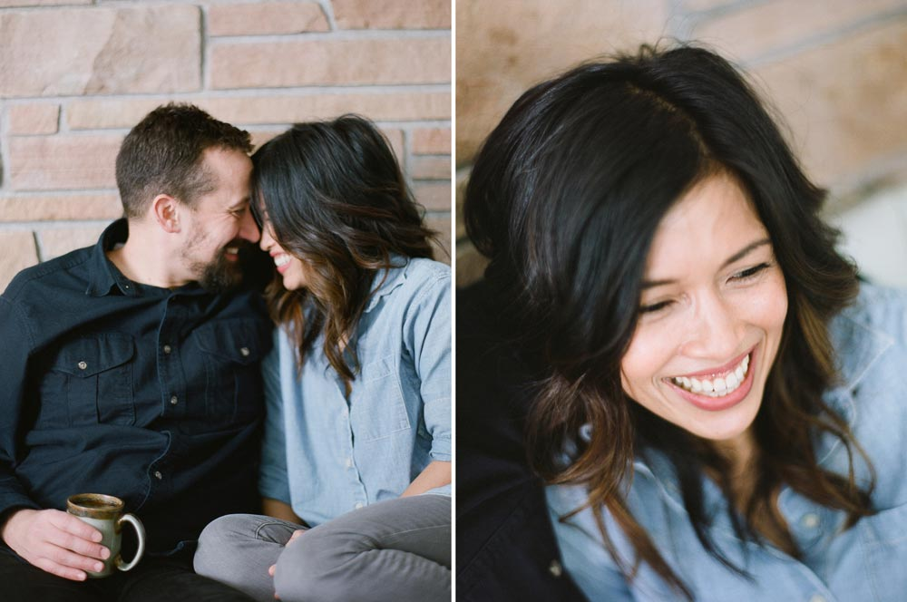 Seattle in home family photography : mom and dad smiling touching foreheads and mom laughing