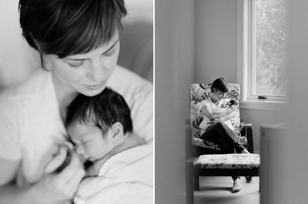 in home newborn session seattle wa : mom cuddling newborn on glider in nursery