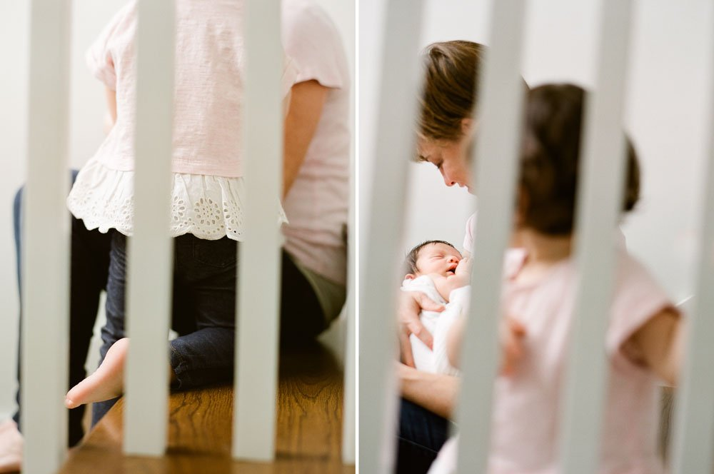 in home newborn session seattle wa : mom and daughter on stairs cuddling newborn