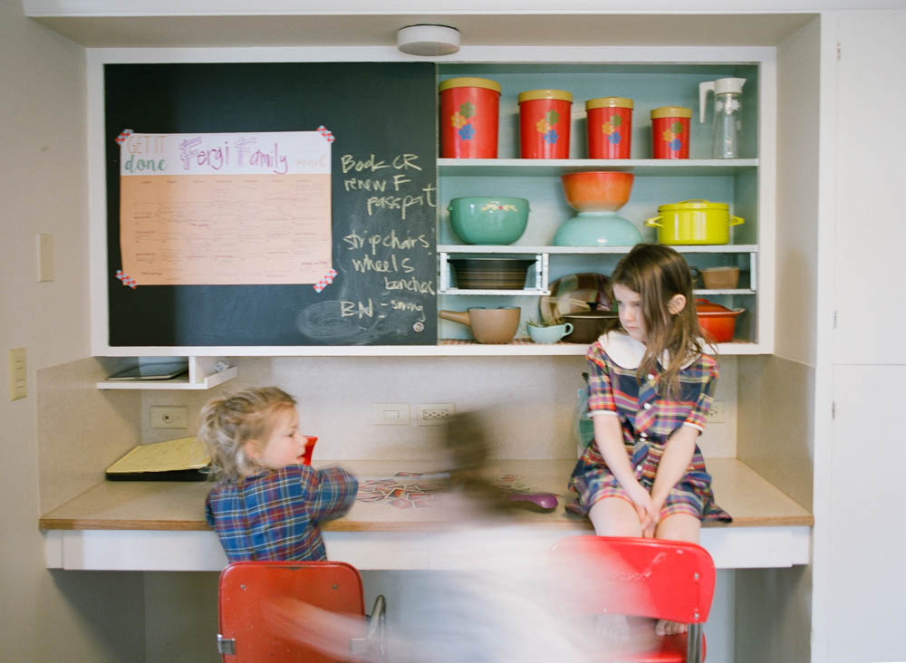 in home family photography seattle : kids hanging out in kitchen