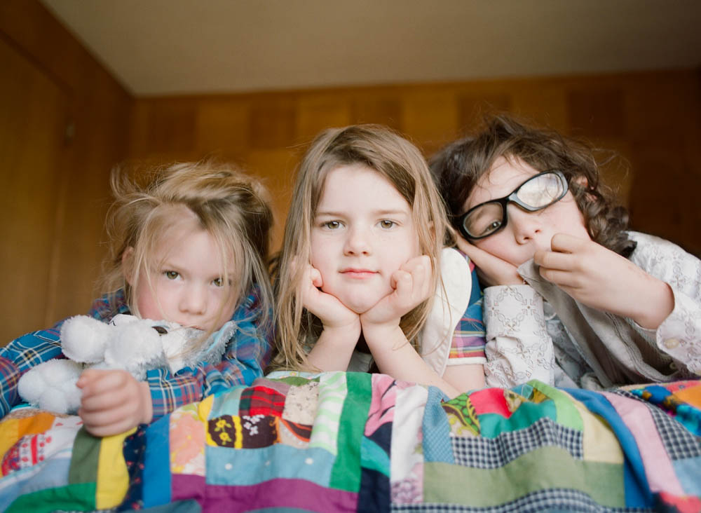 in home family photography seattle : three kids staring