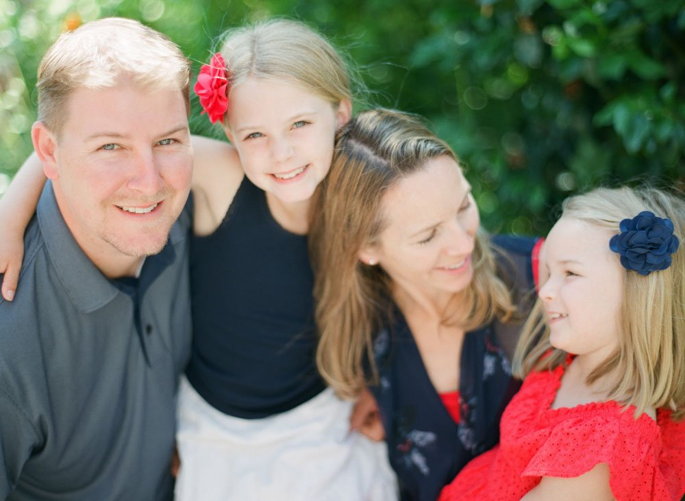 family photographers seattle : family laughing with each other