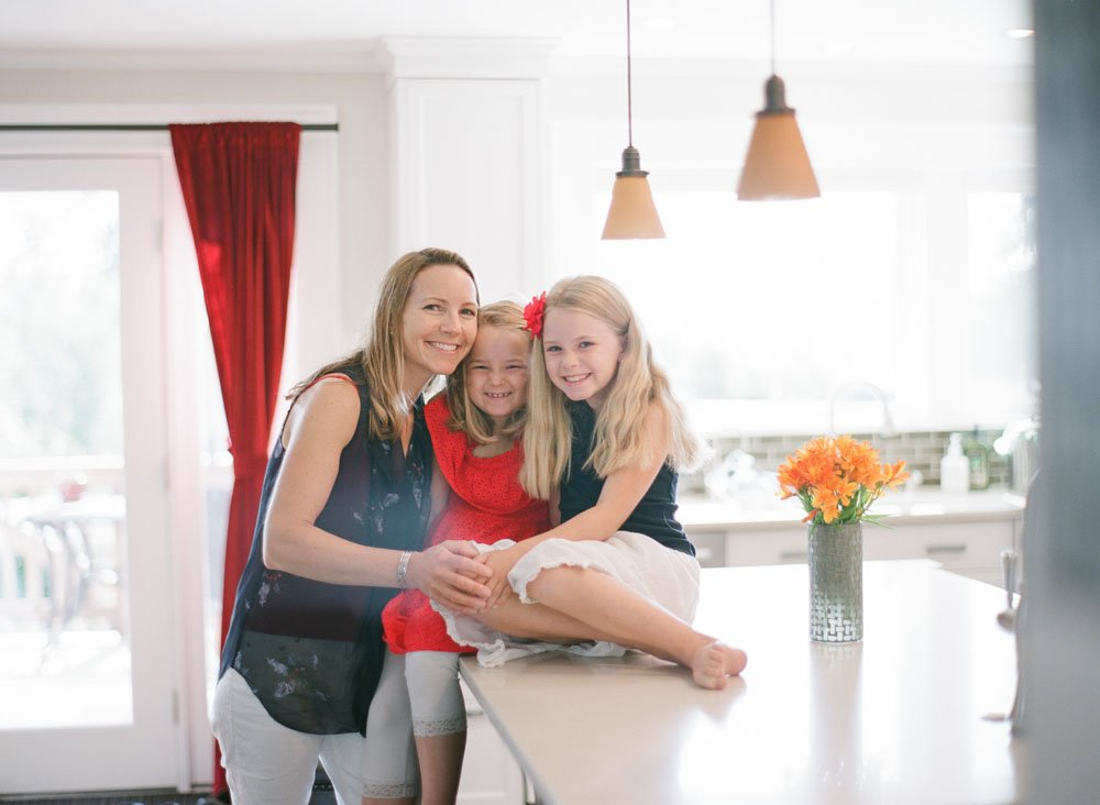family photographers seattle : mom and daughters hanging out in kitchen