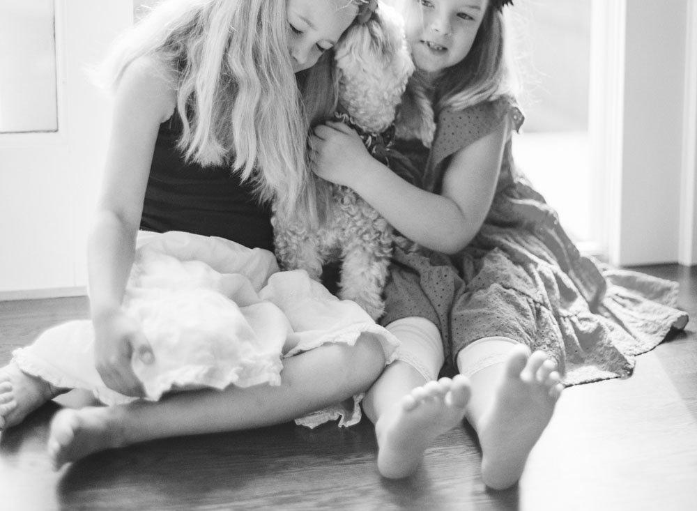 family photographers seattle : sisters cuddling dog