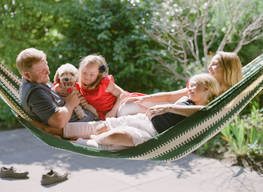 family photographers seattle : family and dog lounging in hammock