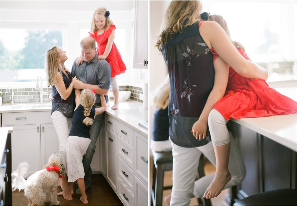 family photographers seattle : family laughing in kitchen