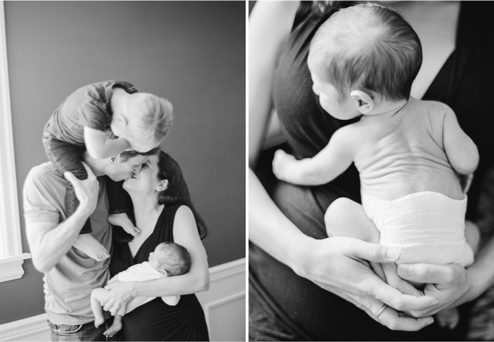 newborn photographers seattle : family with newborn cuddling and kissing