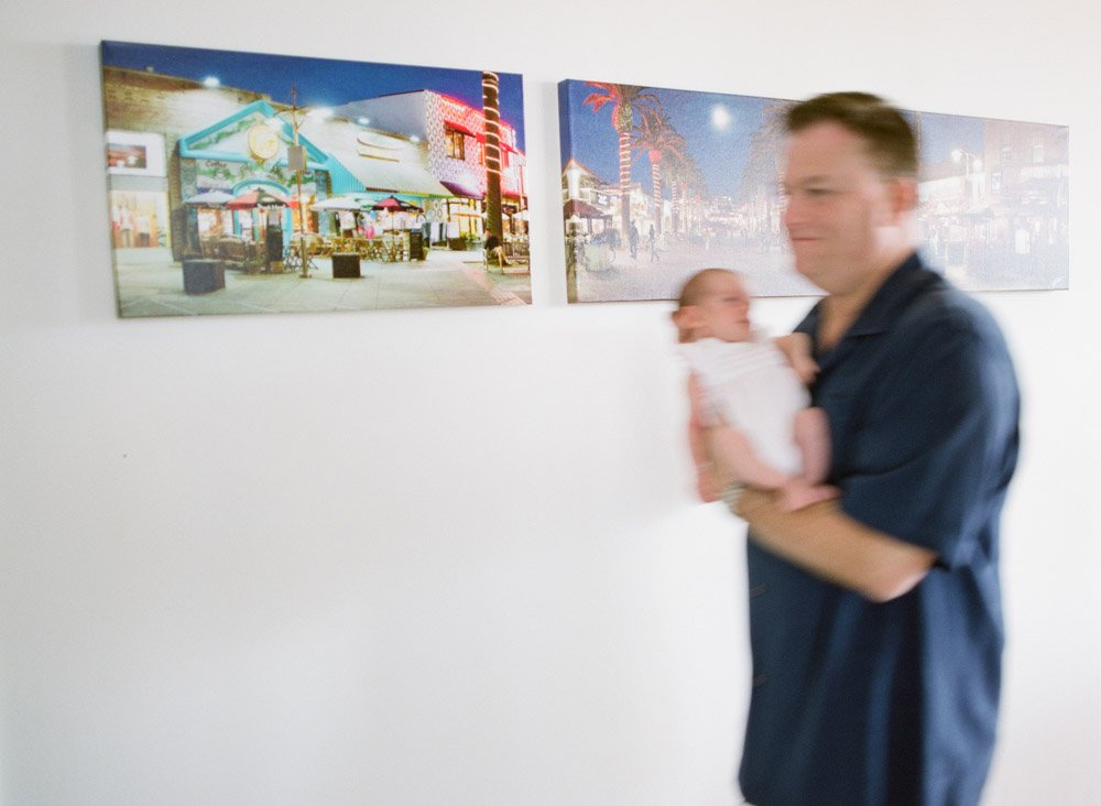 seattle infant photography : dad walking down hallway with newborn blurred