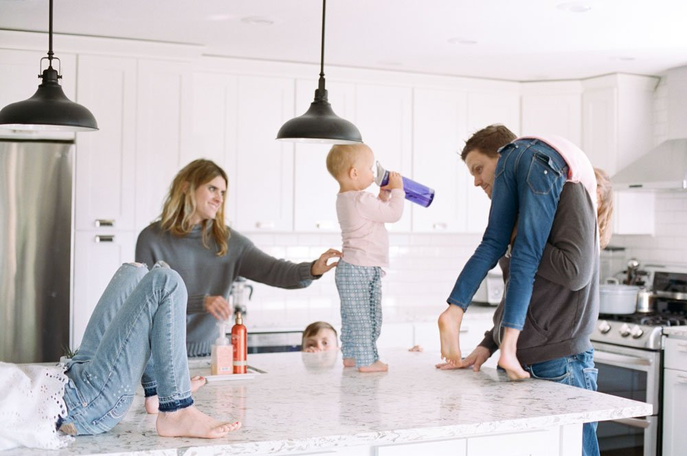 child photography seattle : family hanging out in kitchen