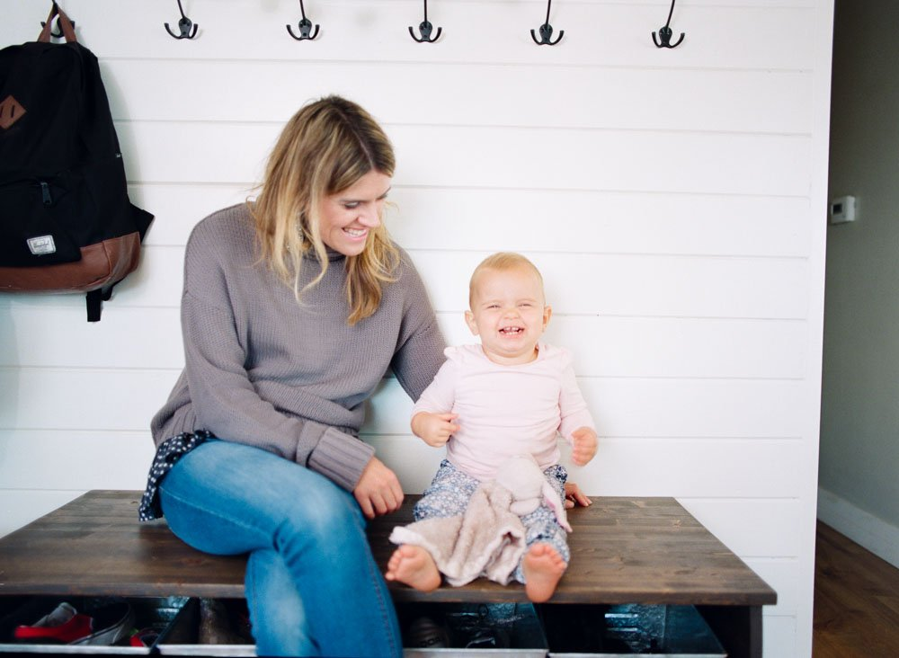 child photography seattle : mom and baby laughing in house