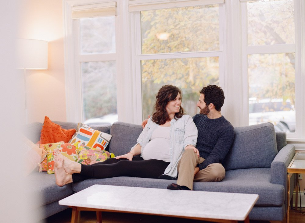 maternity photographer seattle : couple hanging out on couch