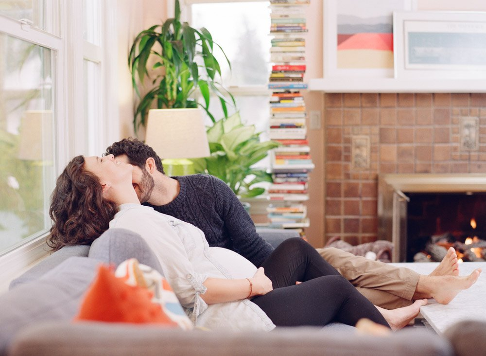maternity photographer seattle : couple relaxing on couch