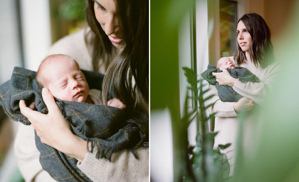 mom holding newborn baby surrounded by plants