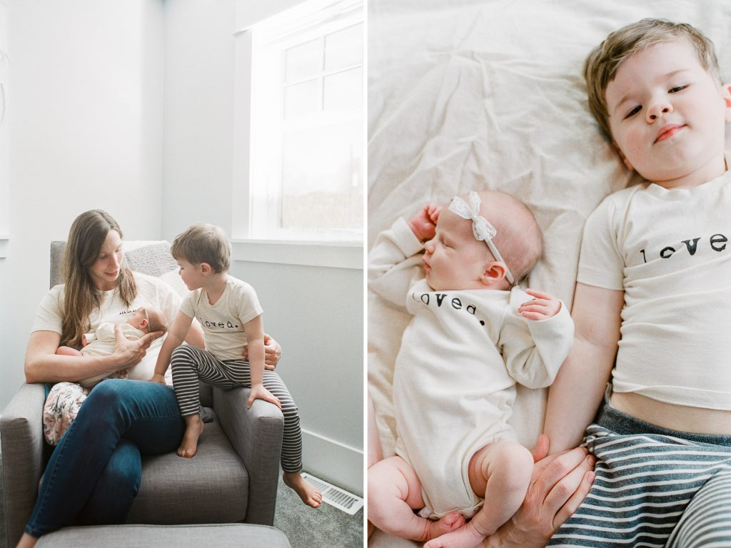 toddler hanging out with mom and newborn baby in nursery